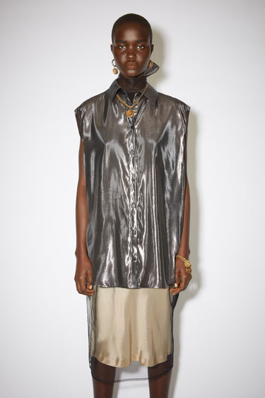 Acne Studios silver metallic sleeveless shirt is made of a silk blend with a relaxed fit.
