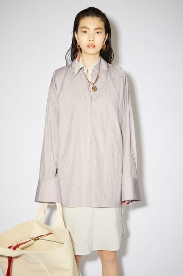 Acne Studios long sleeve shirt is made of crinkled cotton with a relaxed fit.