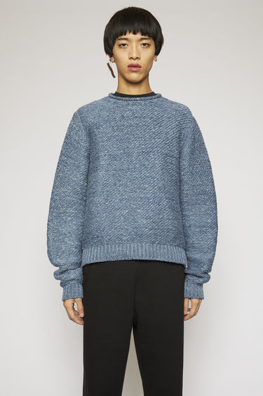 Acne Studios denim blue sweater is knitted with thick yarns to an oversized fit and finished with ribbed cuffs and hem.
