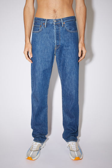 Acne Studios dark blue jeans are made from from rigid denim with a high rise and a straight leg.