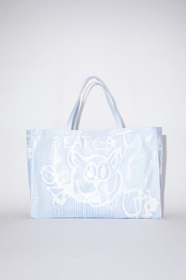 Acne Studios pale blue oilcloth tote bag features a Welcome to Stockholm graffiti print.
