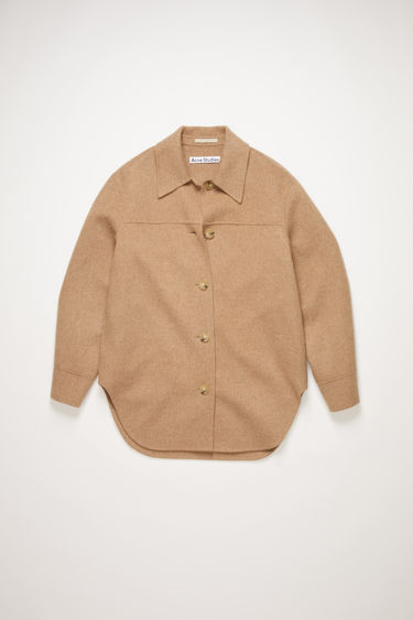Acne Studios camel melange overshirt is crafted from wool to an oversized silhouette and features a spread collar, dropped sleeves and a curved hem.