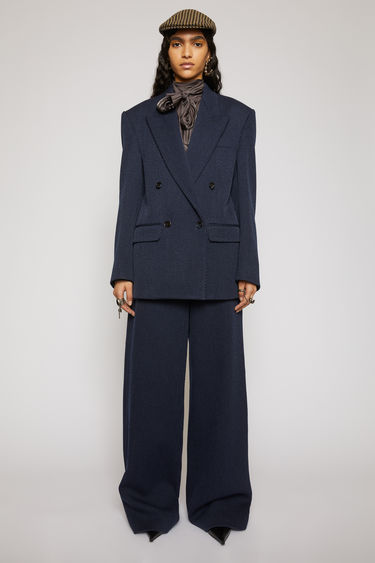 Acne Studios navy/black twill suit jacket is constructed to a slightly oversized, boxy shape and has lightly padded shoulders, peak lapels and a double-breasted front.