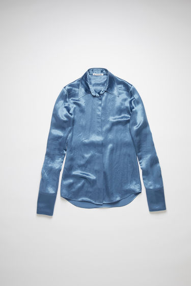 Acne Studios dusty blue long sleeve shirt is made of fluid satin with a fitted silhouette.
