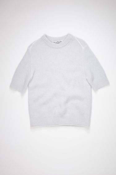 Acne Studios ice blue short sleeve sweater is made of a soft, luxurious alpaca blend with a shrunken fit.