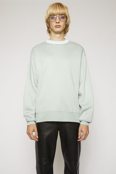 Acne Studios cold grey sweatshirt is crafted to an oversized fit from technical brushed jersey and detailed with a ribbed logo-neck trim.