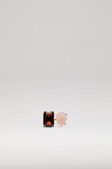 Acne Studios pink/orange ring is crafted with a slim open band and embellished with two different gemstones on each end.