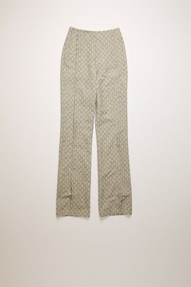 Acne Studios ink blue trousers are crafted from floral jacquard that's shaped to sit on the waist with slim, flared legs and then finished with stitched folds through the front.