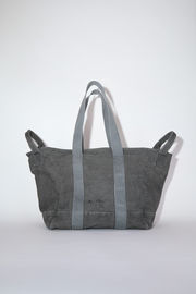 Acne Studios dark grey canvas tote bag is made of cotton with webbing shoulder straps and carrying handles.