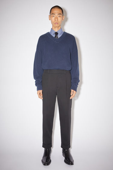 Acne Studios black casual structured trousers are made of a cotton blend with a slight stretch and a tapered fit.