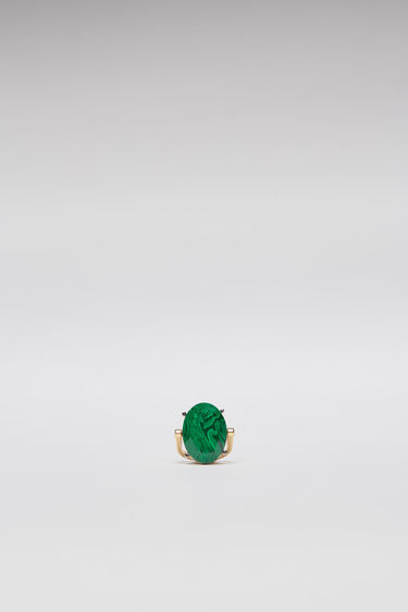 Acne Studios green ring is crafted from gold-tone brass to a slim band and embellished with an oval-shaped faceted stone.