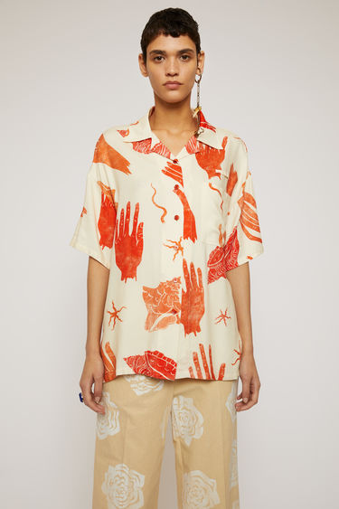 Acne Studios white/red shirt is shaped to a relaxed fit with dropped shoulder seams and wide, short sleeves and illustrated with hand and shell motifs.