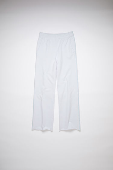 Acne Studios pale blue elastic waist sweatpants are made of cotton with a relaxed fit.