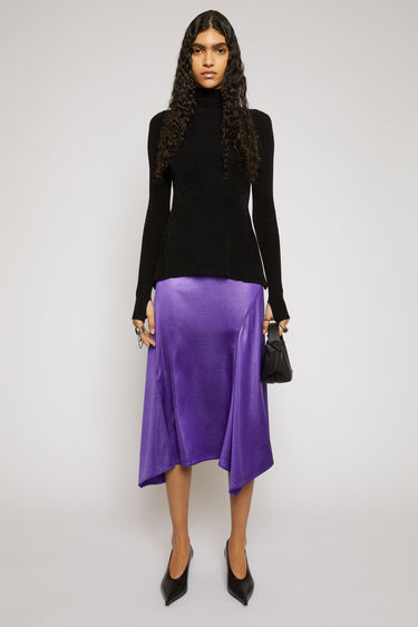 Acne Studios electric purple skirt is crafted from bias-cut satin with a lightly creased finish, that sits high on the waist and falls in draped asymmetric panels to a knee-length hem.