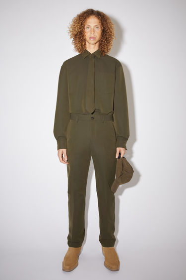 Acne Studios hunter green suit trousers are made of a cotton blend with a classic fit.