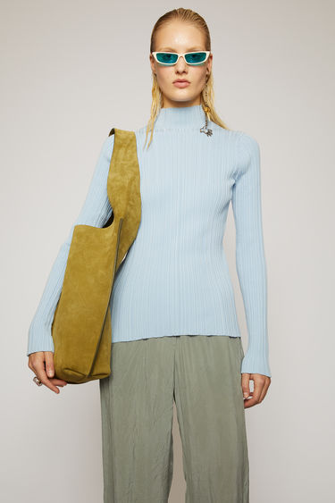 Acne Studios ice blue mock neck sweater is knitted from mercerized cotton with an irregular rib pattern and shaped to a figure-skimming fit.
