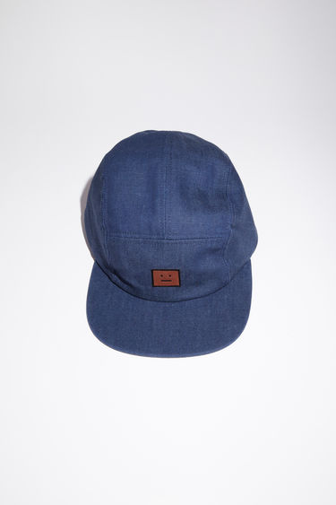 Acne Studios indigo blue baseball cap is made from organic cotton denim with a face logo patch.