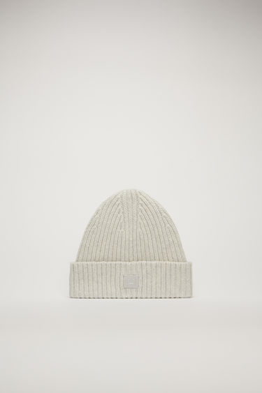 Acne Studios Mini Pansy N Face light grey melange beanie is rib-knitted from soft wool and detailed with a face-embroidered patch on the turn-up brim.