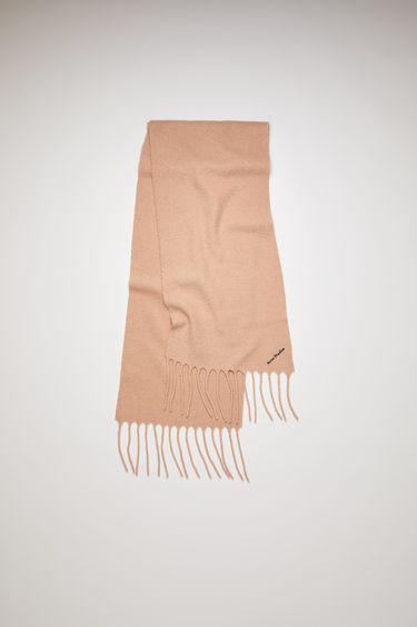Acne Studios wheat beige scarf is crafted from soft boiled wool-blend and detailed with an embroidered Acne Studios logo.