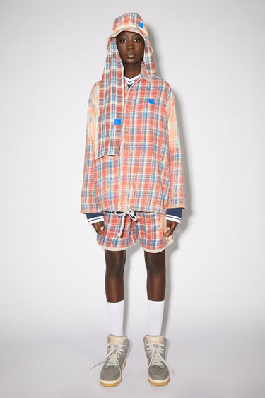 Acne Studios pink/blue lightweight flannel checked overshirt is made of organic cotton with a bleached effect.