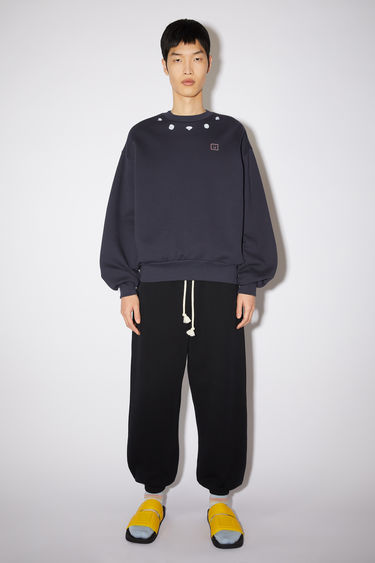 Acne Studios navy relaxed bubble fit sweatshirt is made of organic cotton with a diamond print around the neckline.