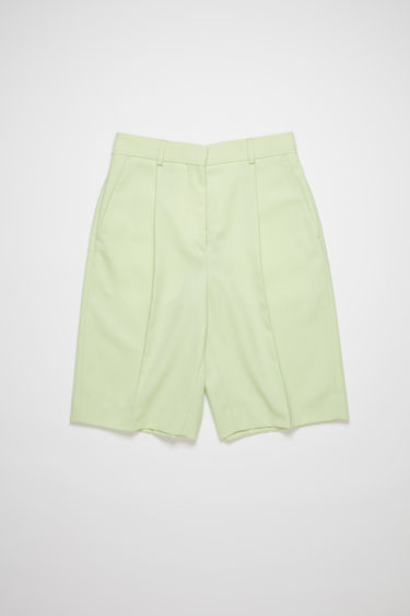 Acne Studios lemon yellow knee-length shorts are made of a wool blend with a classic fit.
