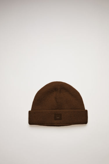 Acne Studios dark brown beanie is knitted with wool and lycra for a closer fit and accented with a tonal face-embroidered patch on front.
