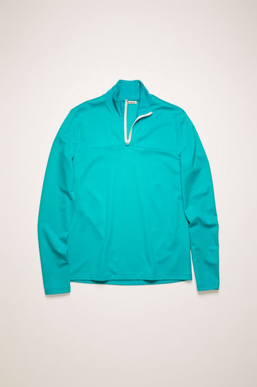 Acne Studios aqua blue sweatshirt is made from technical interlock jersey with a ribbed stand collar and features a branded half-zip closure.