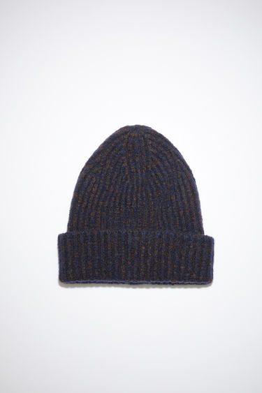 Acne Studios navy/brown beanie is knitted with melange of wool and cashmere yarns in a chunky ribbed pattern and neatly framed with a turn-up brim.