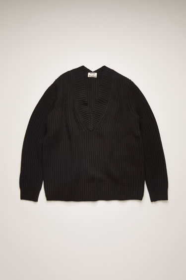 Acne Studios black sweater is crafted from wool and features a ribbed-knit texture for a boxy fit.