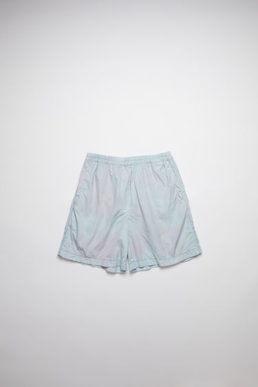 Acne Studios powder blue/lilac crinkled tie dye shorts are made of cotton with an elastic waistband.