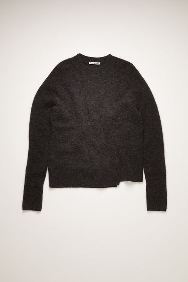 Acne Studios washed black sweater is crafted from soft alpaca and wool-blend to a relaxed silhouette with a ribbed collar and has a stepped hem and a shifted side seam.