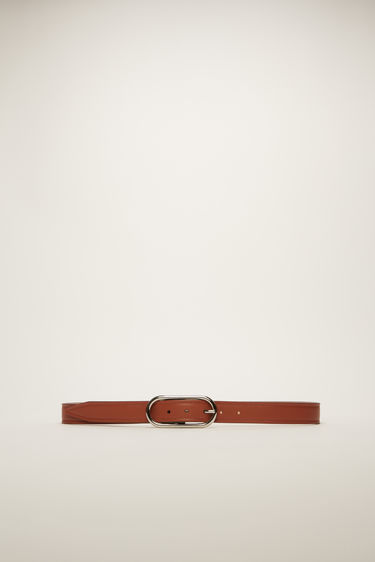Acne Studios almond brown leather belt is crafted to a slender shape with an oval metal buckle and then delicately punctured with several holes.
