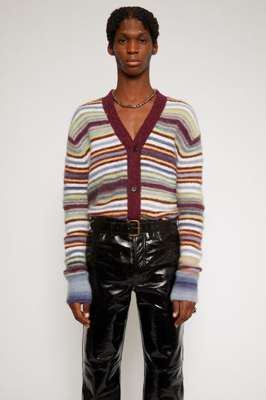 Acne Studios burgundy multi cardigan is knitted from soft alpaca and wool-blend yarn and features a variegated stripe design. It has a V neckline and drop-shoulder sleeves to frame the relaxed shape.