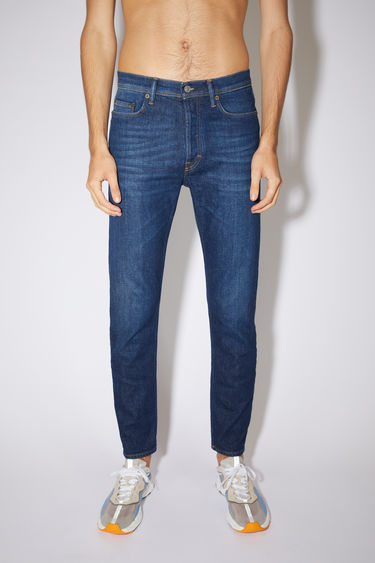 Acne Studios dark blue jeans are made from from comfort stretch denim with a high rise and a slim, tapered leg.