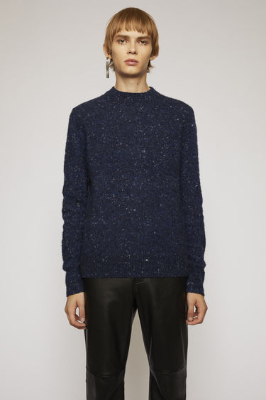 Acne Studios blue melange sweater is designed to look like an old favourite. It's made from a soft wool and cashmere blend with a pilled texture and finished with ribbed trims.
