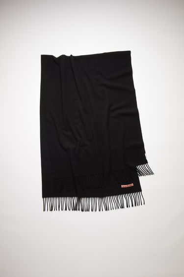 Acne Studios black oversized fringed scarf is made of pure wool, featuring a label in one corner.