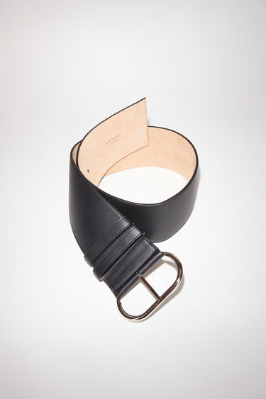 Acne Studios black wide minimalist belt is made of leather and closes with an oval-shaped branded buckle.