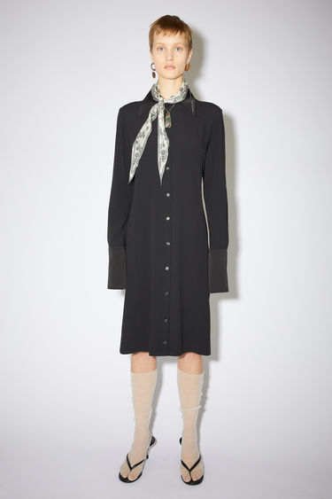 Acne Studios black long sleeve crepe shirt dress has contrasting details and a fitted silhouette.