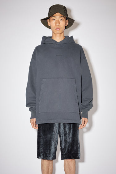 Acne Studios slate grey oversized hooded sweatshirt is made of cotton and features an Acne Studios logo on the front.