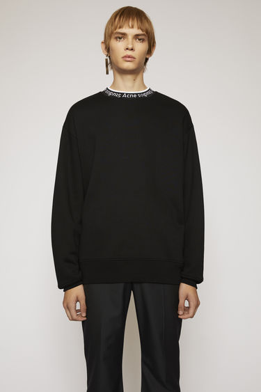 Acne Studios black sweatshirt is crafted to an oversized fit from technical brushed jersey and detailed with a ribbed logo-neck trim.