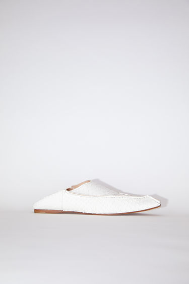 Acne Studios off white flat, slip-on shoes are made of snake embossed leather, inspired by Moroccan babouche slippers.