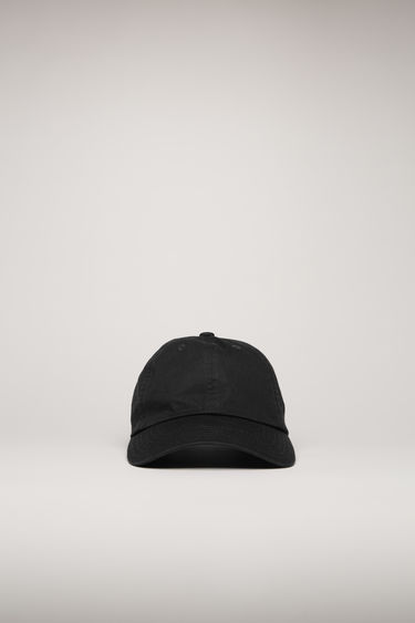 Acne Studios black cap is crafted from cotton to a classic six-panel shape with a curved brim and accented with a tonal face-embroidered patch.