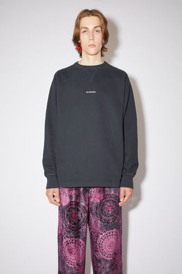 Acne Studios black sweatshirt is made from organically grown cotton that's garment dyed for a soft handle and features a raised logo lettering on front.