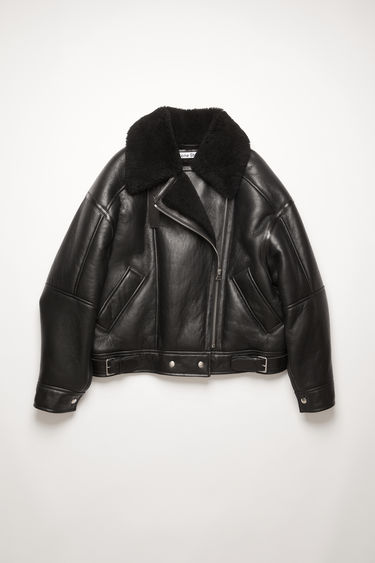 Acne Studios black/black shearling jacket is crafted with soft lamb shearling and framed with tonal leather trims.