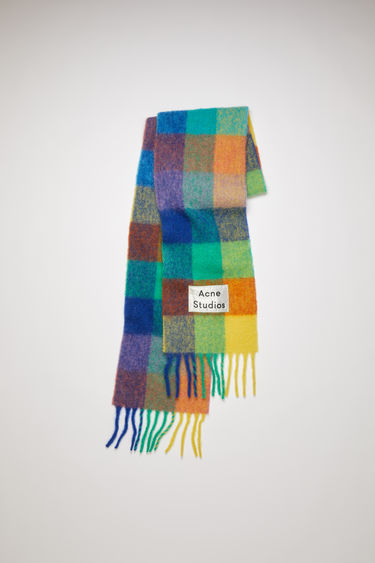 Acne Studios blue/orange/green fringed scarf is woven in multi check pattern and detailed with a logo patch.
