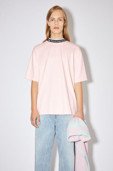 Acne Studios powder pink t-shirt is made of a viscose blend with logo binding at the crew neck.