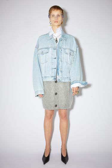 Acne Studios light blue cropped jacket is made of rigid cotton denim with an oversized fit.