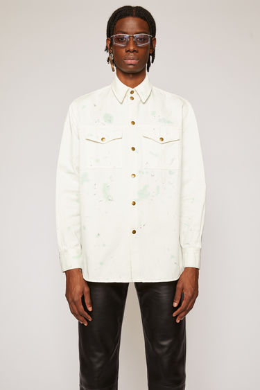 Acne Studios white multicolour overshirt is crafted from stonewashed rigid denim that's splattered with paint for a worn-in look. It's cut to a relaxed fit with dropped shoulders and accented with antiqued metal snap buttons.