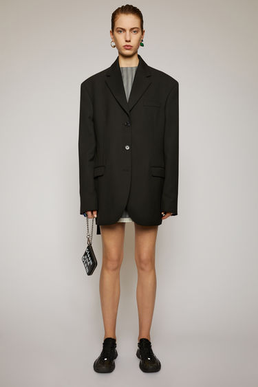 Acne Studios black jacket is cut to an oversized fit with dropped shoulder seams and finished with a single-breasted buttoned front and an adjustable back belt.